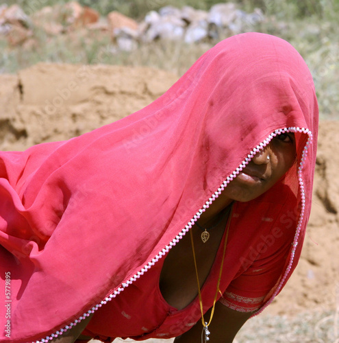 village woman taking break from work, rajasthan, india