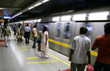 passengers awaiting metro train, delhi, india poster