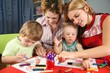 children painting with his mothers