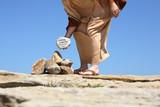 Man standing sandy rocks holding a rock with verse John 8, poster