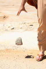 Man dropping  stone from  hand.  mercy, pardon, forgiveness