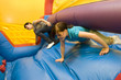 Two Girls Racing in inflatable toy