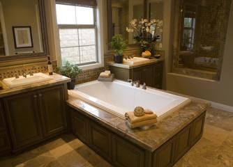 Spacious bathroom with a modern tub.