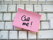 message call me post-it note on a computer keyboard