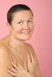 Soft and intimate portrait of a naturally beautiful older woman