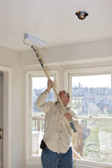 Contract painter painting ceilings