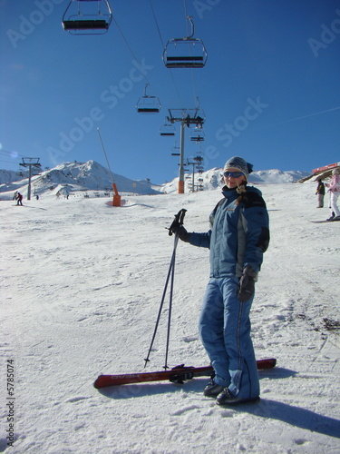 The young girl on a mounting skiing resort in Andorra