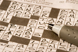 Newspaper crossword puzzle being solved by exercising the brain poster