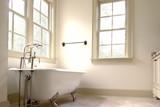minimalist bathroom with clawfoot tub poster