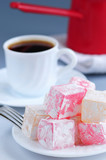 Turkish delight confection with black coffee and coffee pot poster