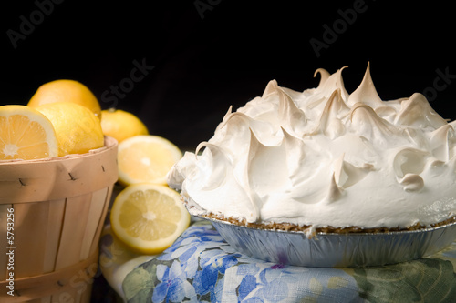 Basket of lemons with lemon meringue pie.