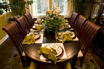 Festive dining table with luxurious dinnerware.