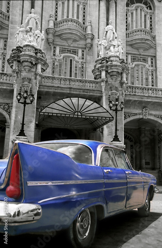 antic blue car parked in front of an hotel - la havana - Cuba
