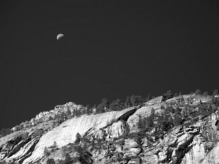 Half moon over cliff in Yosemite National Park, monochrome
