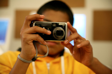 Young man taking pictures with a digital camera