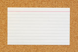 lined index card on cork board background poster