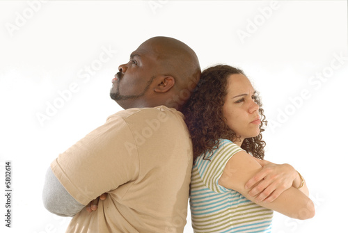 Adult couple upset with each other and looking stubbornly away