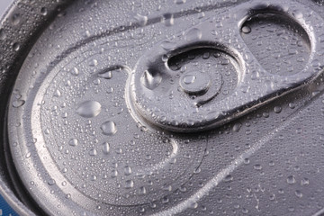 Macro view of the tab of an unopened beverage can