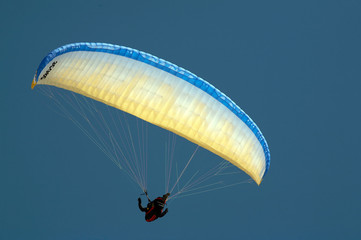 colorful paraglider against the blue sky