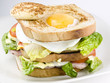 sandwich with egg, cheese and vegetables.