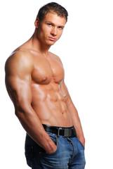 Sexy body of beautiful young guy. Posing in studio.