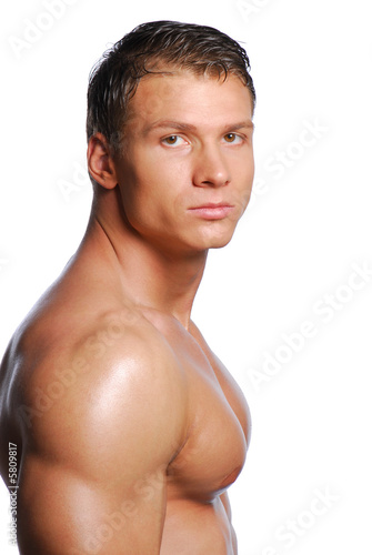 Portrait of beautiful sexy guy. Posing in studio.