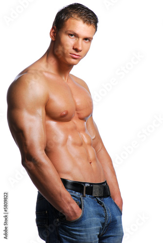 Sexy body of beautiful young guy. Posing in studio.