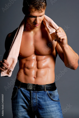 Beautiful athlete holding  towel. Sport image.