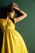 Fashionable pretty woman in yellow dress