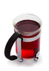 Glass of red Tea. Isolated over white.