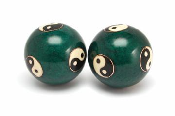Yin Yang hand massage balls. Isolated on white.