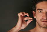 Man pulling his beard with tweezers poster