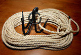 Grappling Hook attached to a Coil of Sisal Rope poster