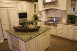 Kitchen and island with modern stove. poster