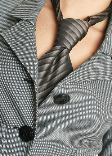 Detail of a business woman suit with tie