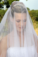 A bride with a veil on her head before wedding ceremony