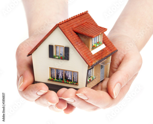 canvas print picture The house in human hands