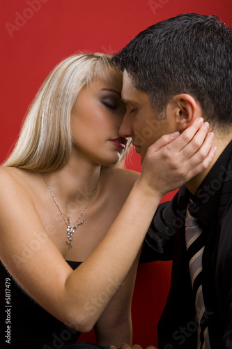 Young, kissing couple.