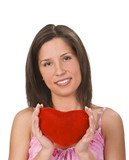 Beautiful young brunette holding a red plush heart shape. poster