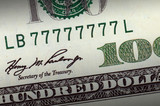 One hundred dollar bill with lucky number highlighted poster