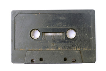 Old black and dirty 80's audio cassette tape .
