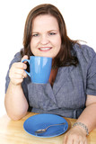 Pretty plus-sized businesswoman on a coffee break.