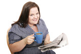 Pretty plus-sized businesswoman drinking coffee