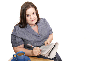 Plus-sized businesswoman reads classifieds,