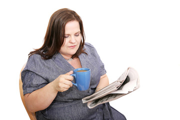 Beautiful plus-sized woman reading the newspaper