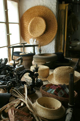 Old Sewing Machine and Straw Hats