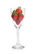 Modern twist stem wine glass filled with ripe strawberries