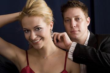 Boyfriend attaching blond womans new necklace