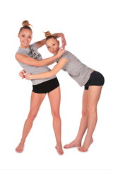 Twin sport girls encirlce each other by hands