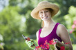 Smiling pretty woman gardener